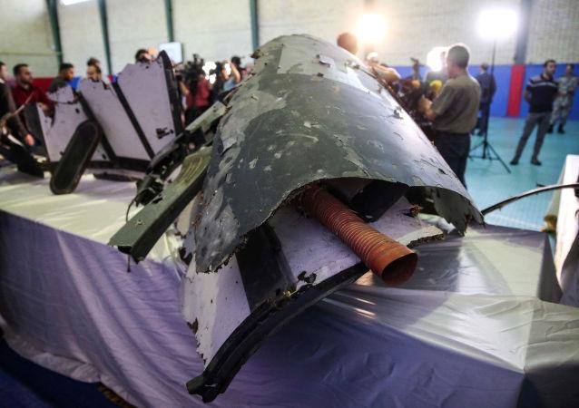 Los restos de un dron de EEUU derribado por Irán cerca del estrecho de Ormuz