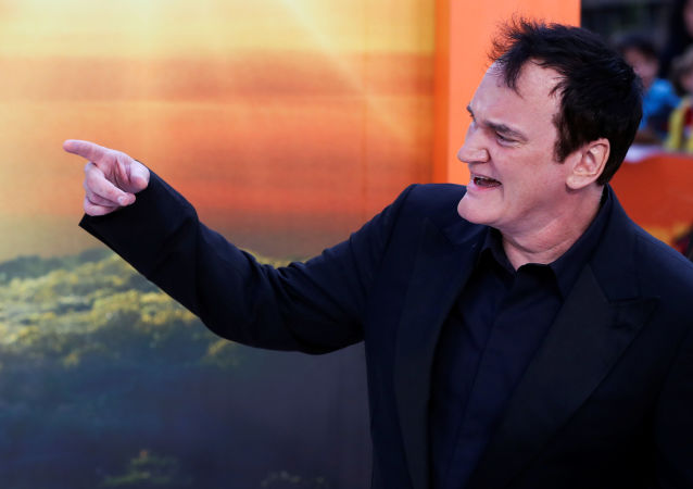 Director Quentin Tarantino gestures as he arrives for the London premiere of Once Upon a Time in Hollywood, in London, Britain July 30, 2019. REUTERS/Simon Dawson