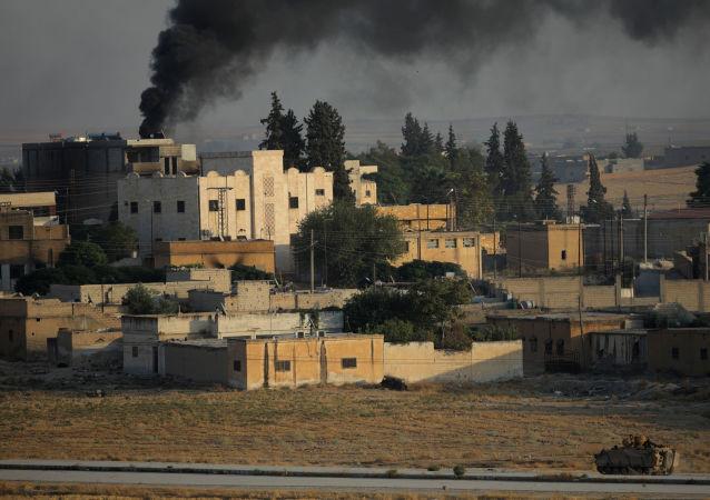 El humo sobre la ciudad siria, Tel Abiad