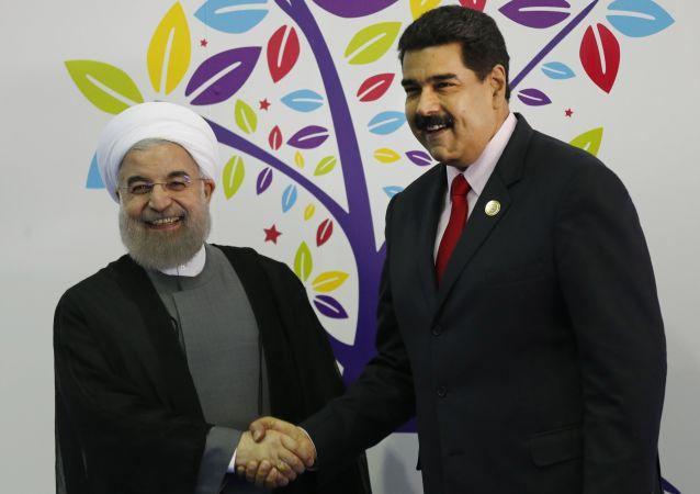 El presidente de Irán, Hasán Rouhaní junto al presidente de Venezuela, Nicolás Maduro