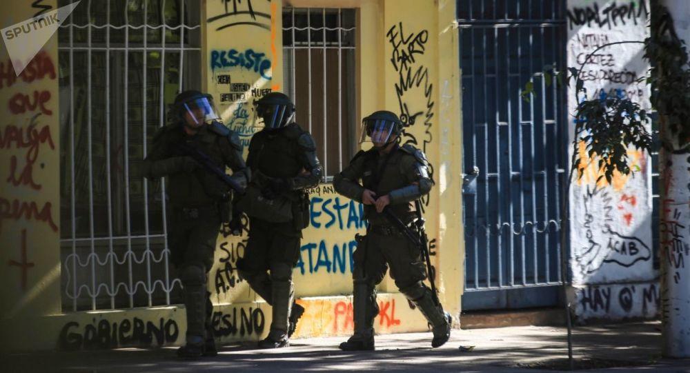 Carabineros de Chile disparan hacia los manifestantes (archivo)
