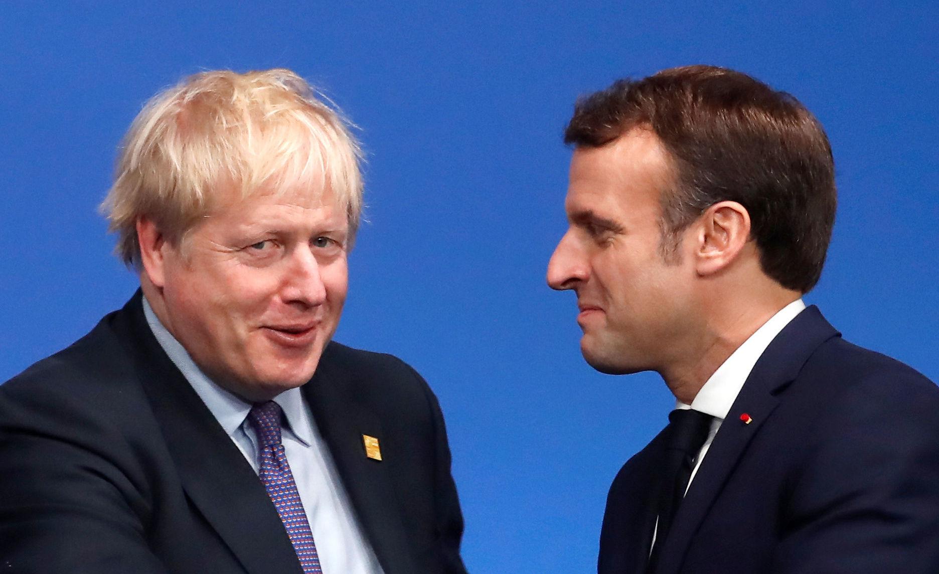El primer ministro de Reino Unido, Boris Johnson, junto al presidente de Francia Enmanuel Macron en la Cumbre de líderes de la OTAN