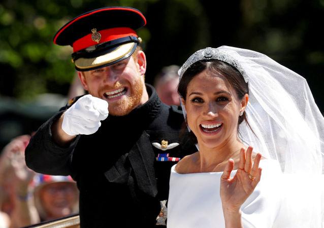 El príncipe Enrique y su esposa, Meghan Markle, el día de su boda (archivo)