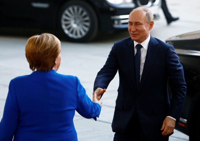La canciller alemana, Angela Merkel, y el presidente de Rusia, Vladímir Putin, en Berlín