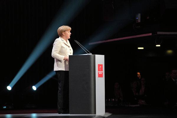 Канцлер ФРГ Ангела Меркель выступает на торжественном открытии Ганноверской промышленной ярмарки