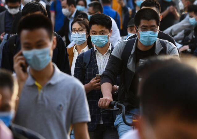 Gente en las calles de Pekín, China