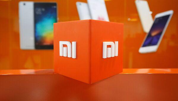 El logo de Xiaomi - Sputnik Mundo