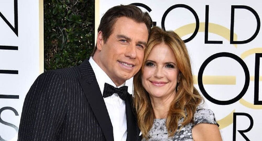 John Travolta junto a Kelly Preston