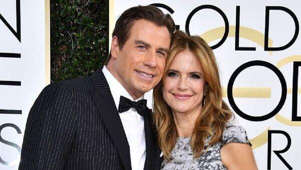 John Travolta junto a Kelly Preston - Sputnik Mundo