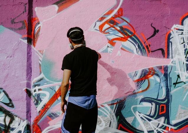 Un grafitero, imagen referencial