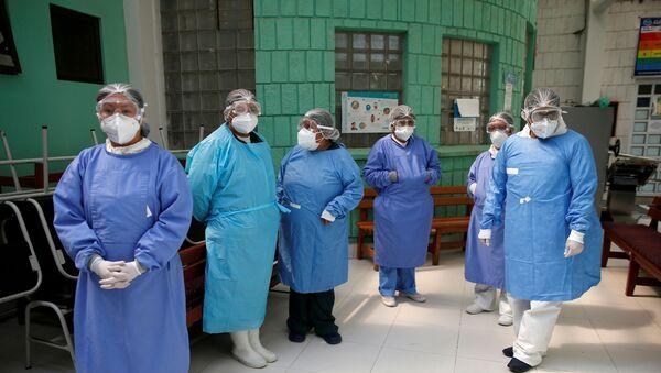 Grupo de médicos - Sputnik Mundo