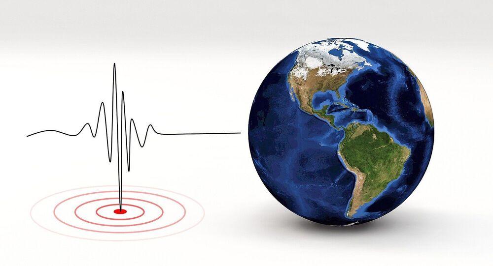 Imagen referencial de un sismógrafo y la Tierra
