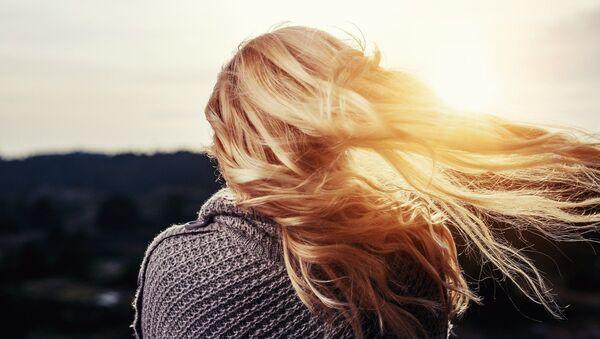 El cabello de una mujer - Sputnik Mundo