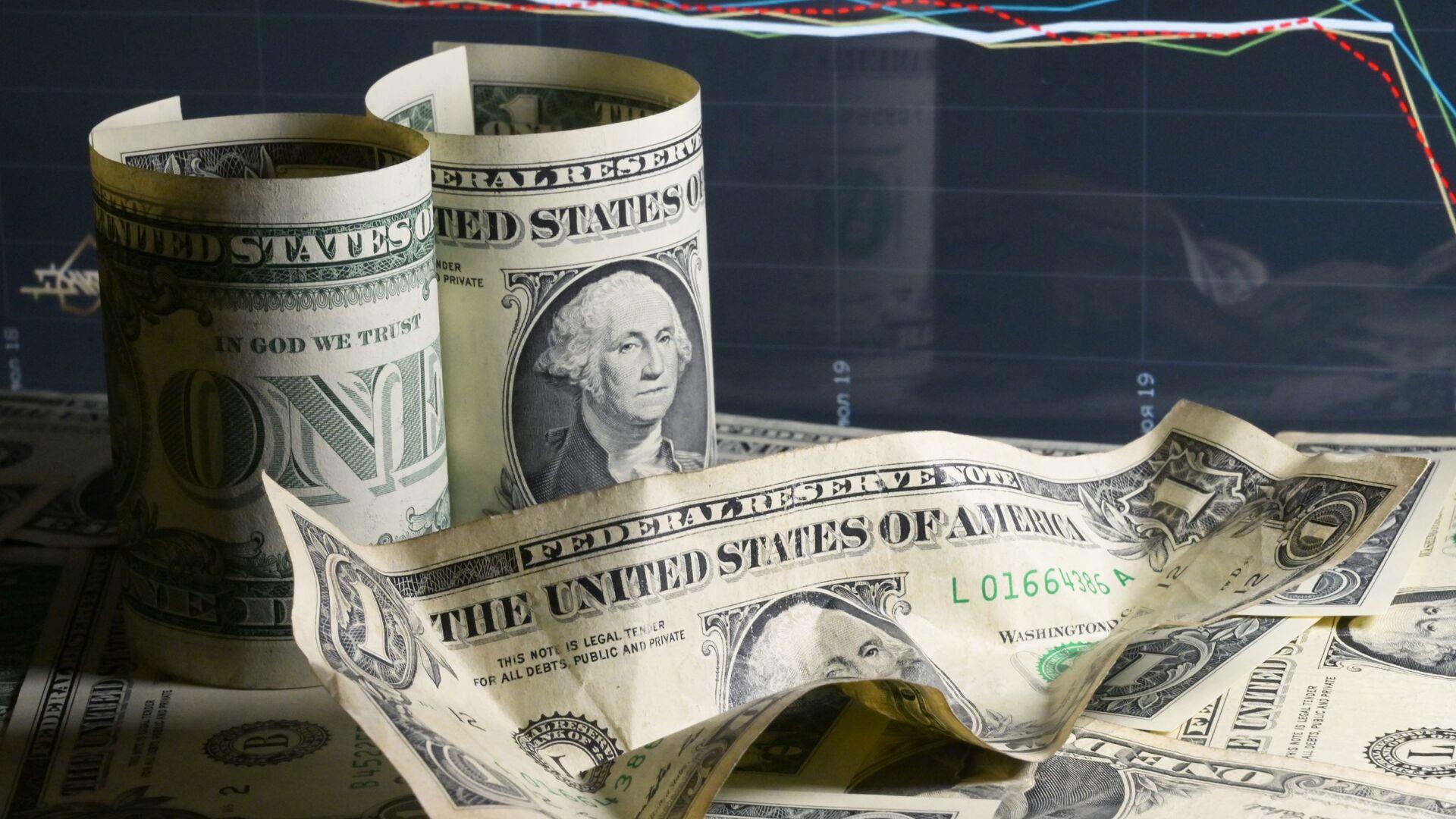 Unos billetes de dólares de EEUU - Sputnik Mundo, 1920, 21.02.2021