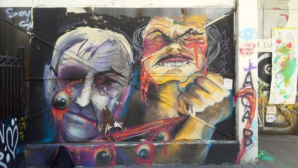 Mural realizado durante el estallido social en Chile - Sputnik Mundo