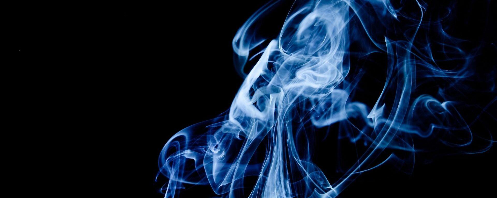 Imagen referencial de humo de tabaco - Sputnik Mundo, 1920, 05.07.2021