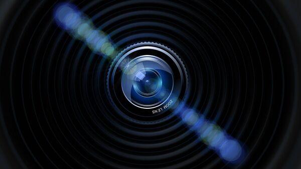 Una cámara oculta, imagen ilustrativa - Sputnik Mundo