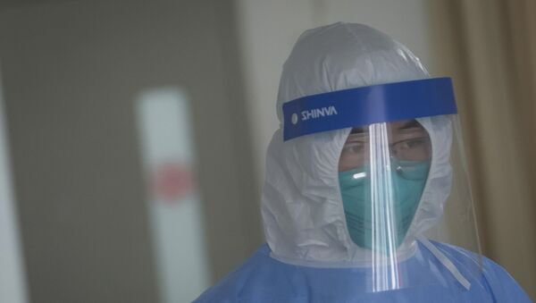 Una médica china - Sputnik Mundo