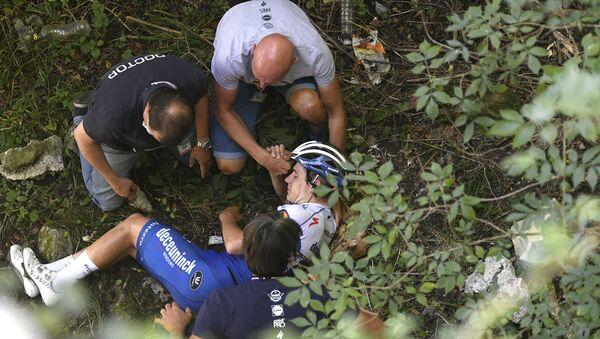 Remco Evenepoel, ciclista belga, tras su caída durante el Giro de Lombardía en Muro di Sormano (Italia), el 15 de agosto de 2020 - Sputnik Mundo