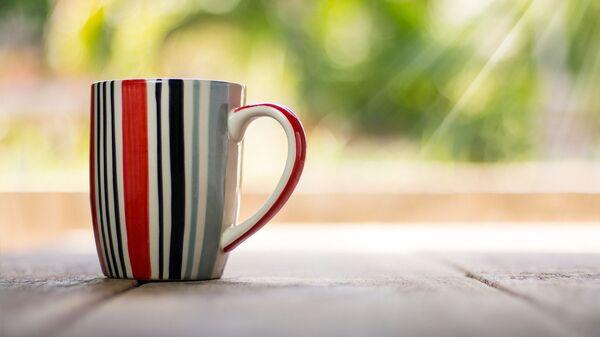Una taza de bebida, referencial - Sputnik Mundo
