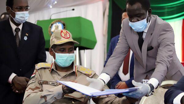 La firma de paz en Sudán - Sputnik Mundo