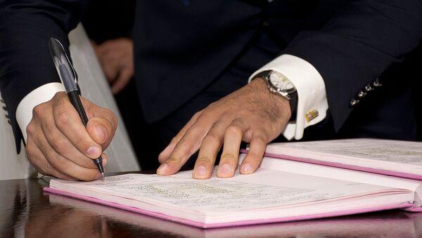 La firma de un acuerdo (imagen referencial) - Sputnik Mundo