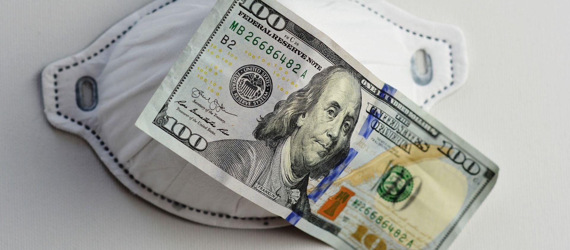 Una mascarilla y un billete de 100 dólares - Sputnik Mundo, 1920, 08.12.2020