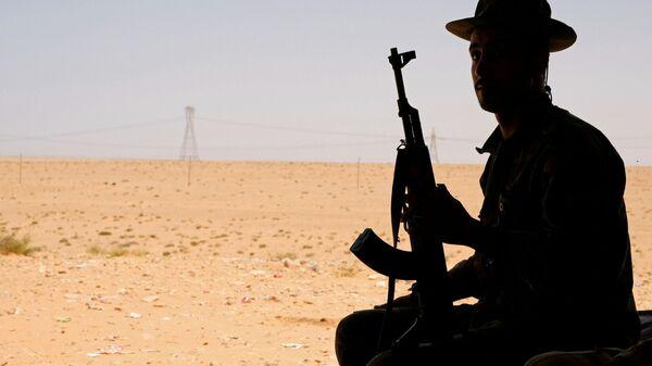 Un miembro del Ejército de Hatar en Libia - Sputnik Mundo