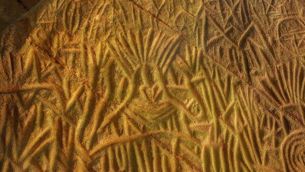 Un petroglifo (imagen referencial) - Sputnik Mundo