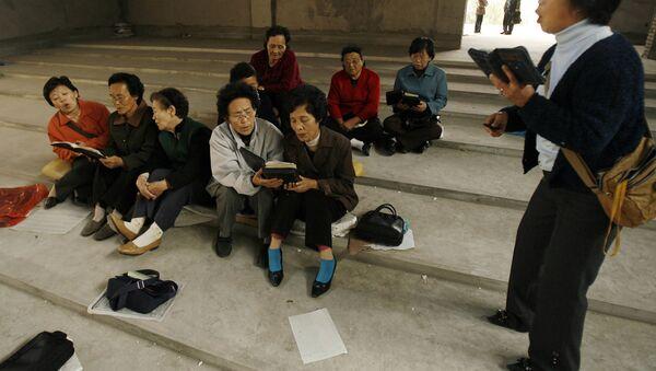 Cristianos coreanos en la ciudad de Yanji - Sputnik Mundo