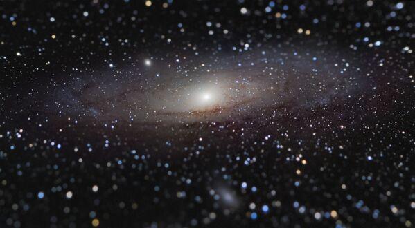La foto 'Andromeda Galaxy at Arm's Length' ('la galaxia de Andrómeda al alcance de la mano'), de Nicolas Lefaudeux (Francia), ganador del concurso.  - Sputnik Mundo