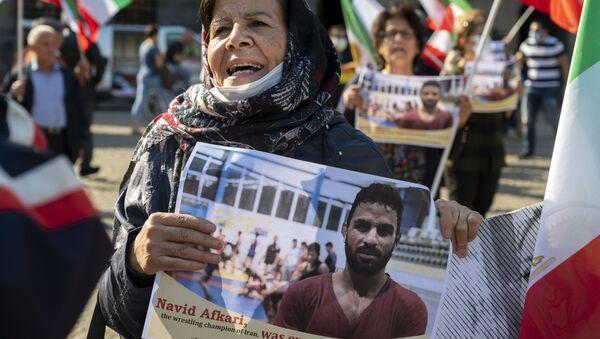 Una manifestación contra la ejecución del luchador Navid Afkari - Sputnik Mundo