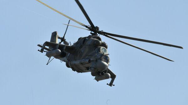 Helicóptero Mi-24 durante las maniobras Kavkaz 2020 - Sputnik Mundo