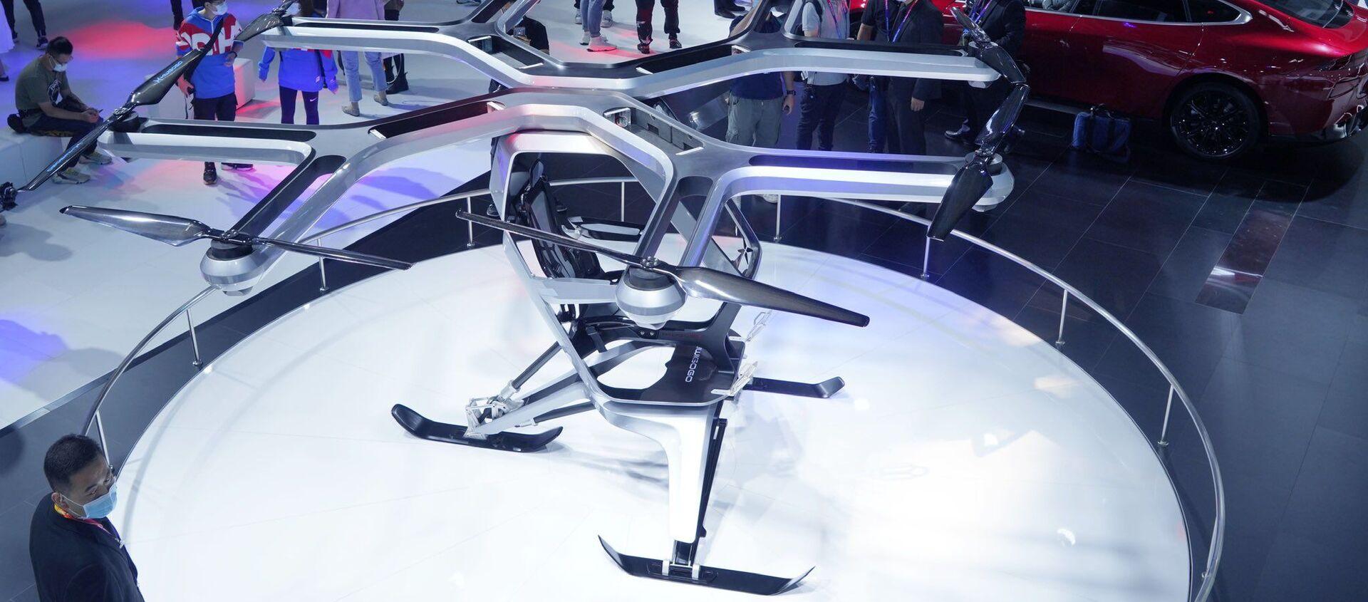 El prototipo de vehículo volador Kiwigogo de Xpeng Motors se exhibe en el Auto China 2020 - Sputnik Mundo, 1920, 27.09.2020