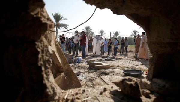 Consecuencias del ataque con cohetes en Irak - Sputnik Mundo