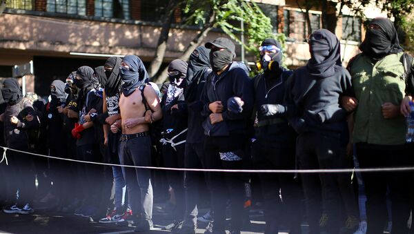 Manifestantes en México - Sputnik Mundo