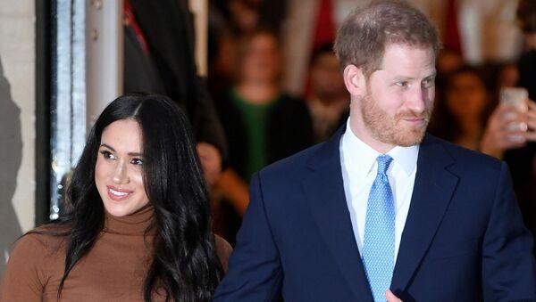 El príncipe Harry y su esposa, Meghan Markle - Sputnik Mundo