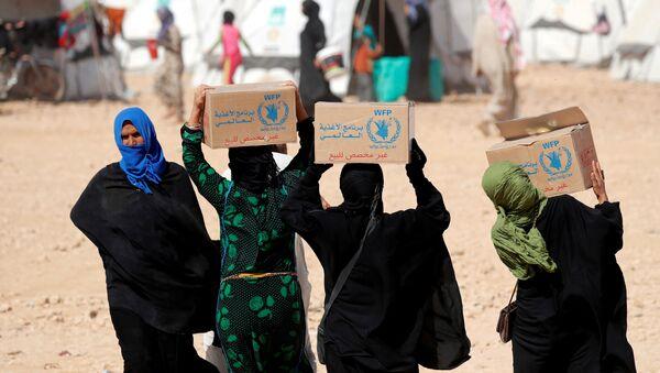 Mujeres sirias con la ayuda alimentaria del Programa Mundial de Alimentos (PMA) - Sputnik Mundo