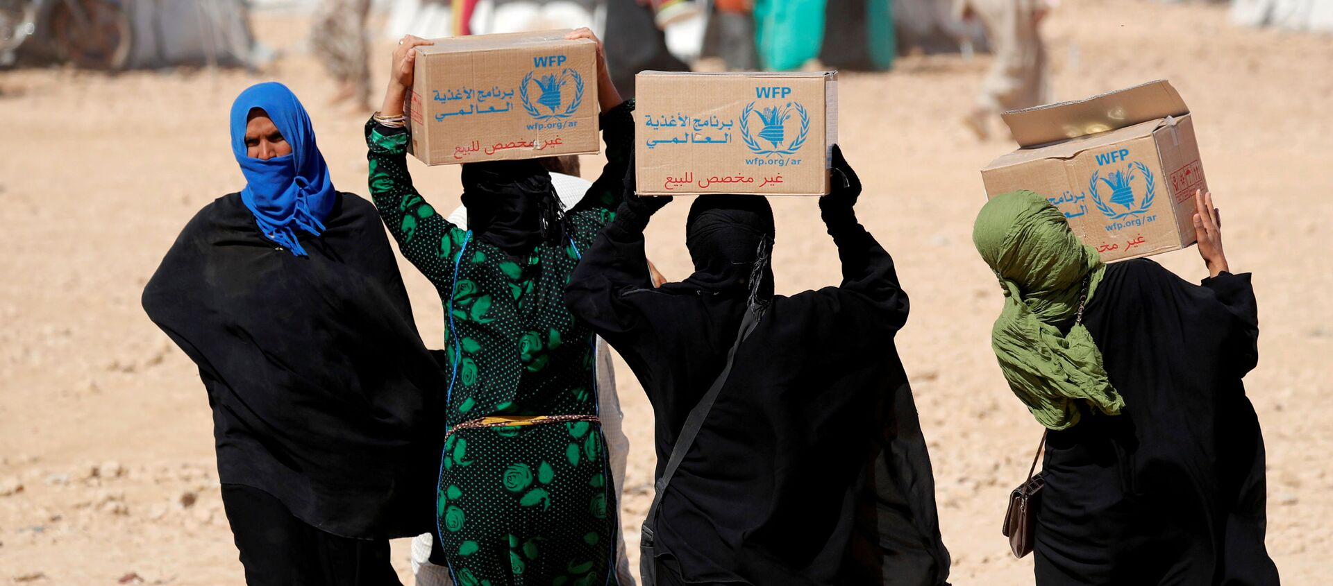 Mujeres sirias con la ayuda alimentaria del Programa Mundial de Alimentos (PMA) - Sputnik Mundo, 1920, 09.10.2020