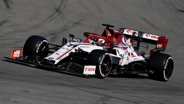 Bólido de Alfa Romeo pilotado por Kimi Raikkonen - Sputnik Mundo