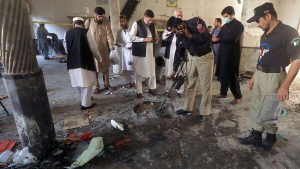 Consecuenias de una explosión en una madrasa pakistaní - Sputnik Mundo