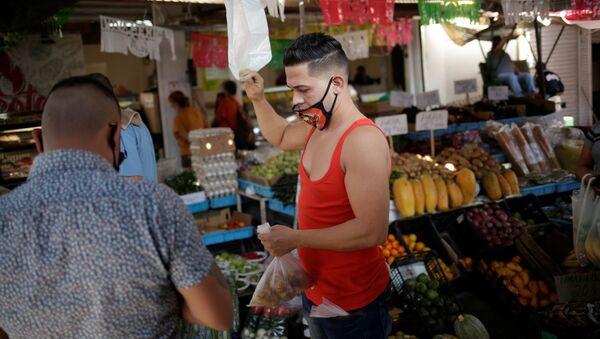 Trabajador de un mercado de Ciudad Juarez - Sputnik Mundo