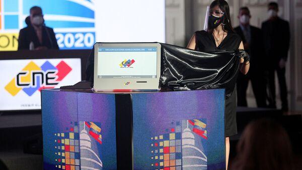 Una máquina de votación en Venezuela - Sputnik Mundo