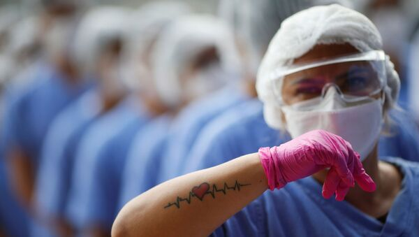 Una médica en Brasil - Sputnik Mundo