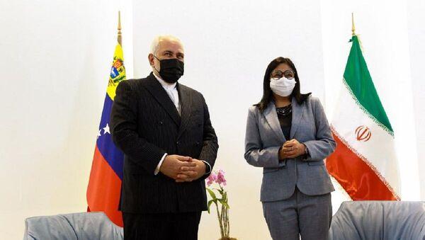 Mohamad Yavad Zarif, ministro de Exteriores de Irán, y Delcy Rodríguez, vicepresidenta de Venezuela - Sputnik Mundo