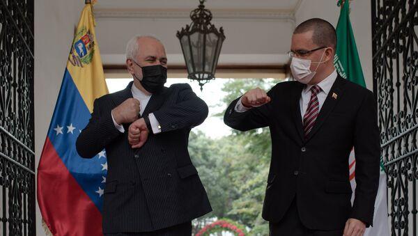 El Ministro de Relaciones Exteriores de Irán, Mohammad Javad Zarif, con su homólogo venezolano, Jorge Arreaza - Sputnik Mundo