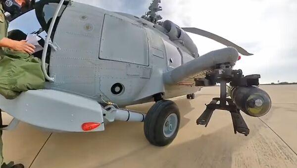 Maniobras para lanzar un misil AGM-114 Hellfire - Sputnik Mundo