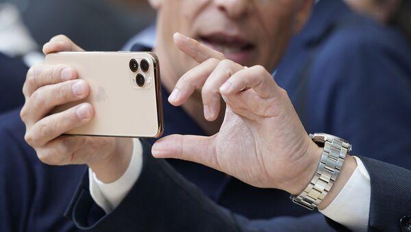 Un iPhone 11 Pro - Sputnik Mundo