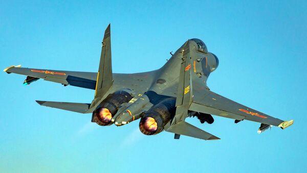 Un caza multipropósito J-11BS - Sputnik Mundo