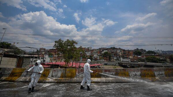 Trabajos de desinfección de las calles de Caracas, Venezuela - Sputnik Mundo